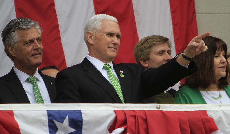 From left, Mayor Eddie DeLoach, Vice President Mike Pence and Karen Pence watch the parade from the balcony at Savannah's City Hall during the St. Patrick's Day Parade in Savannah, Ga., on Saturday, March 17, 2018. (Philip Hall/Savannah Morning News via AP)