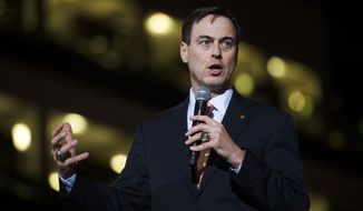 FILE - In this March 2, 2017, file photo, Tennessee new athletic director John Currie speaks during a ceremony introducing him at Thompson-Boling Arena in Knoxville, Tenn. Tennessee has reached a $2.5 million settlement with former athletic director Currie less than four months after he was suspended in the midst of a football coaching search. Currie already had received nearly $280,000 since being placed on paid leave in December. School officials announced Thursday, March 22, 2018, that Currie will get an additional $2.2 million no later than April 1. (Caitie McMekin/Knoxville News Sentinel via AP, File)