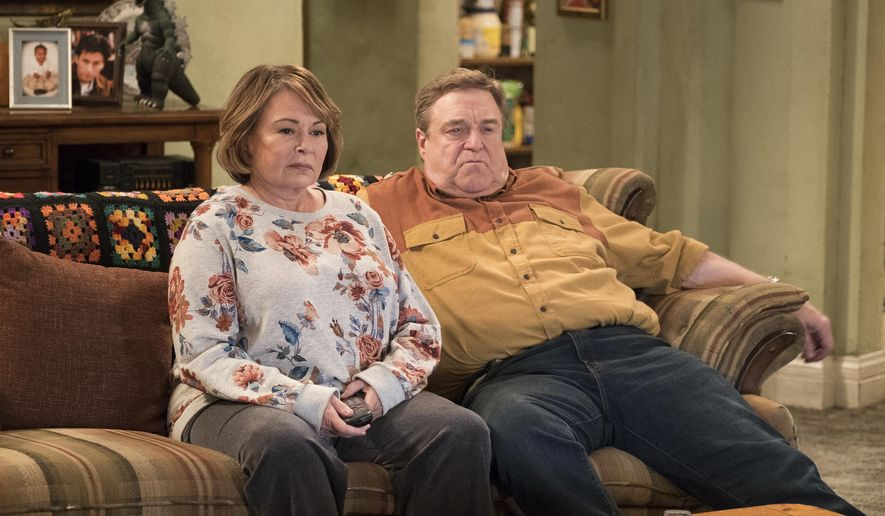 """In this image released by ABC, Roseanne Barr, left, and John Goodman appear in a scene from the reboot of """"Roseanne,"""" premiering on Tuesday at 8 p.m. EST. (Adam Rose/ABC via AP)"""