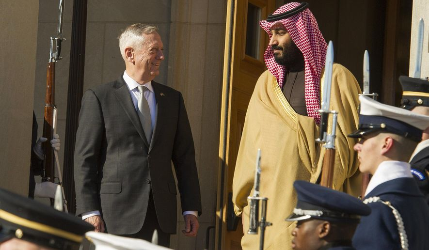 Defense Secretary Jim Mattis welcomes Saudi Crown Prince Mohammed bin Salman to the Pentagon with an Honor Cordon, in Washington, Thursday, March 22, 2018. (AP Photo/Cliff Owen)