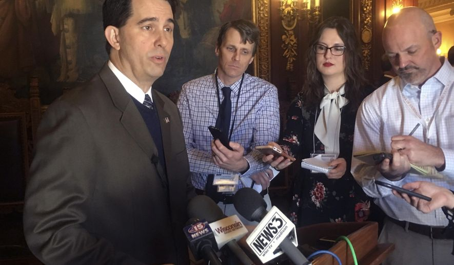"FILE - In this Feb. 14, 2018, file photo, Wisconsin Gov. Scott Walker, speaks to reporters in Madison, Wis. Walker could barely contain himself with the news Thursday, March 22, 2018, that Wisconsin's unemployment rate hit a new record low of 2.9 percent. Walker, who is up for re-election in November, sent a combined 17 tweets on both his official and political Twitter accounts crowing about the news, sometimes with smiling sunglass-wearing emojis, once again referencing one of his favorite pop songs from the 1980s: ""Future's so bright, I gotta wear shades!"" (AP Photo/Scott Bauer, File)"