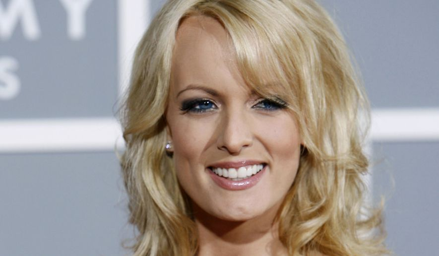 In this Feb. 11, 2007, file photo, Stormy Daniels arrives for the 49th Annual Grammy Awards in Los Angeles. A nonprofit watchdog group has asked the Justice Department and Office of Government Ethics to investigate whether a secret payment to Daniels made prior to the 2016 presidential election violated federal law because Donald Trump did not list it on his financial disclosure forms. (AP Photo/Matt Sayles) ** FILE **