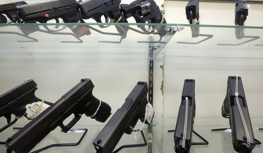 This June 29, 2016, file photo shows guns on display at a gun store in Miami. (AP Photo/Alan Diaz, File) **FILE**