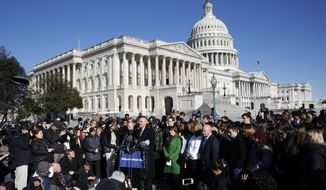Rep. Ted Deutch, D-Fla., speaks at the podium where he is joined by students and parents from Marjory Stoneman Douglas High School, in Parkland., Fla., Friday, March 23, 2018, during a news conference about gun violence on Capitol Hill in Washington, ahead of the Saturday March For Our Lives. With Rep. Deutch are Sen. Amy Klobuchar, D-Minn., Mark Kelly, and Gabby Giffords. (AP Photo/Jacquelyn Martin)