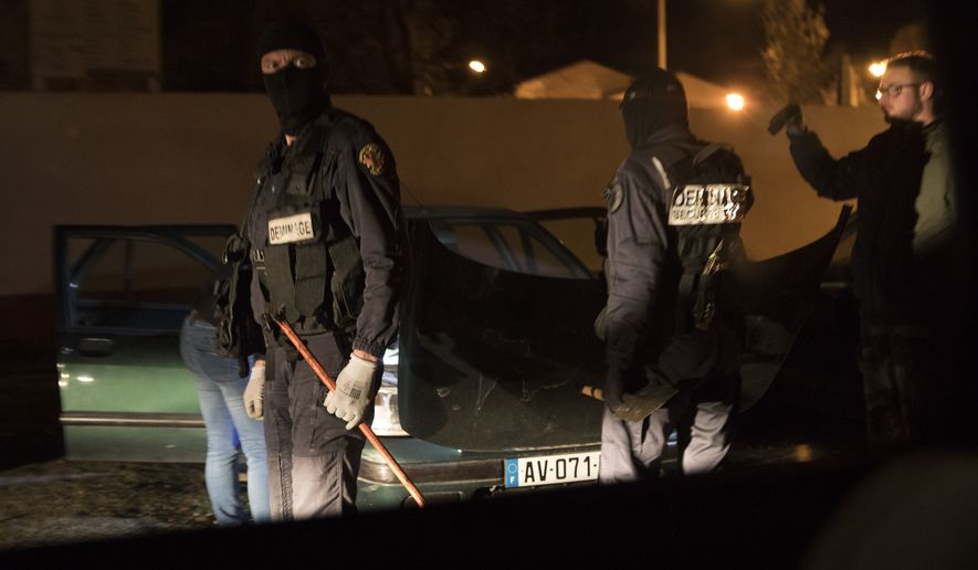 French Police officers search a car during a raid in Carcasona following an incident in Trebes, southern France, Friday March 23, 2018. French counterterrorism prosecutors are taking charge of the investigation after a man went on a rampage, carjacking a vehicle, killing three people including a police officer and taking hostages at a supermarket, before being shot to death by police. (AP Photo/Emilio Morenatti)