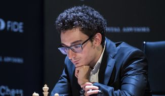 U.S. and Italian chess Grandmaster Fabiano Caruana concentrates during his match against Azerbajan's Shakhriyar Mamedyarov during a qualification tournament of eight Grandmasters in Berlin, Friday, March 23, 2018. (Soeren Stache/dpa via AP) ** FILE **
