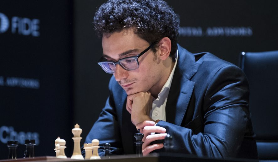 U.S. and Italian chess Grandmaster Fabiano Caruana concentrates during his match against Azerbajan's Shakhriyar Mamedyarov during a qualification tournament of eight Grandmasters in Berlin, Friday, March 23, 2018. (Soeren Stache/dpa via AP)
