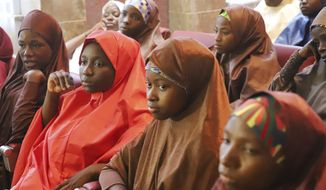 Recently freed School girls from the Government Girls Science and Technical College Dapchi, during a meeting with Nigeria President, Muhammadu Buhari, at the Presidential palace in Abuja, Nigeria, Friday, March 23, 2018. Nigeria's president welcomed to his official residence more than 100 girls who were released by Boko Haram Wednesday after being kidnapped last month.(AP Photo/Azeez Akunleyan) ** FILE **
