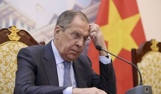 Russian Foreign Minister Sergei Lavrov listens to his Vietnamese counterpart Pham Binh Minh (not pictured) during a press briefing at the Government Guest House, in Hanoi, Vietnam, Friday, March 23, 2018. (Luong Thai Linh/Pool Photo via AP) ** FILE **