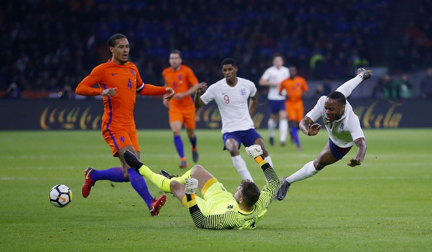 England's Raheem Sterling, right, challenges for the ball with goalkeeper Jeroen Zoet of the Netherlands during the international friendly soccer match between the Netherlands and England at the Amsterdam ArenA in Amsterdam, Netherlands, Friday, March 23, 2018. (AP Photo/Peter Dejong)