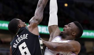 Milwaukee Bucks guard Eric Bledsoe, left, blocks a shot by Chicago Bulls guard David Nwaba during the second half of an NBA basketball game Friday, March 23, 2018, in Chicago. (AP Photo/Nam Y. Huh)