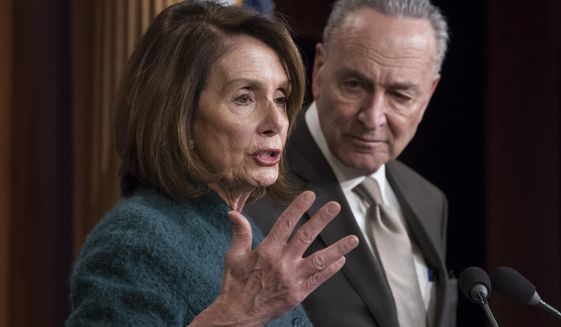 House Minority Leader Nancy Pelosi, D-Calif., and Senate Minority Leader Chuck Schumer, D-N.Y., speak to reporters about the massive government spending bill moving through Congress, on Capitol Hill in Washington, Thursday, March 22, 2018. (Associated Press) **FILE**