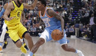 Los Angeles Clippers guard Lou Williams (23) drives on Indiana Pacers guard Cory Joseph (6) during the first half of an NBA basketball game in Indianapolis, Friday, March 23, 2018. (AP Photo/Michael Conroy)