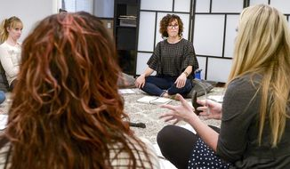 In this March 14, 2018, photo, Kristin Hodson, center, leads a therapist discussion at The Healing Group on a myriad of issues arising in their case consulting, in Salt Lake City. Hodson is one of the leaders of the new sex-positivity movement happening in Utah. Hodson and her group of therapists with The Healing Group focuses on sex and sex-positivity. (Leah Hogsten/The Salt Lake Tribune via AP)