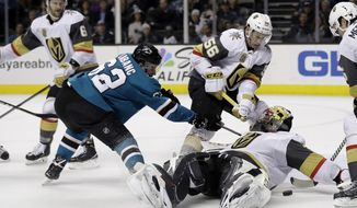 Vegas Golden Knights goaltender Malcolm Subban, bottom right, leans back to stop a shot from San Jose Sharks' Kevin Labanc, left, during the second period of an NHL hockey game Thursday, March 22, 2018, in San Jose, Calif. (AP Photo/Marcio Jose Sanchez)