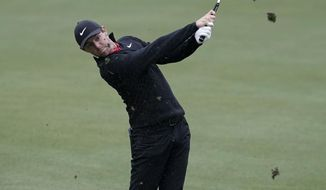 Rory McIlroy, of Northern Ireland, hits on the second hole during round-robin play at the Dell Technologies Match Play golf tournament, Friday, March 23, 2018, in Austin, Texas. (AP Photo/Eric Gay)