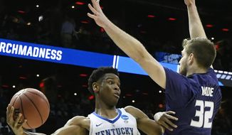 Kentucky guard Shai Gilgeous-Alexander (22) works against Kansas State forward Dean Wade (32) during the first half of a regional semifinal NCAA college basketball tournament game, Thursday, March 22, 2018, in Atlanta. (AP Photo/John Amis)