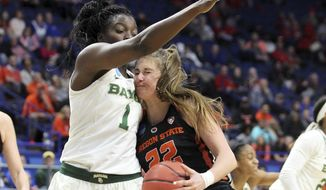 Oregon State's Kat Tudor (22) collides with Baylor's Dekeiya Cohen (1) during the first half of an NCAA women's college basketball tournament regional semifinal Friday, March 23, 2018, in Lexington, Ky. (AP Photo/James Crisp)
