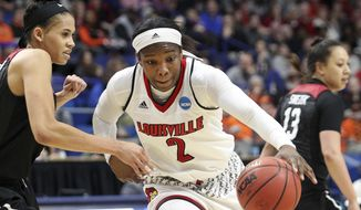 Louisville's Myisha Hines-Allen (2) drives on Stanford's Kaylee Johnson during the first half of an NCAA women's college basketball tournament regional semifinal Friday, March 23, 2018, in Lexington, Ky. (AP Photo/James Crisp)