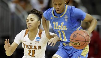 UCLA forward Lajahna Drummer, right, prevents a steal by Texas guard Brooke McCarty, left, during the first half of a women's NCAA college basketball tournament regional semifinal game, Friday, March 23, 2018, in Kansas City, Mo. (AP Photo/Orlin Wagner)