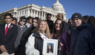 Terri Robinowitz, center, holds a framed photo of her granddaughter Alyssa Alhadeff who was killed in the shootings at Marjory Stoneman Douglas High School, with Alyssa's parents, Lori Alhadeff and Ilan Alhadeff, right, as lawmakers and gun control activists gather at the U.S. Capitol in Washington, Friday, March 23, 2018, a day before the March for Our Lives rally Saturday. (AP Photo/J. Scott Applewhite)