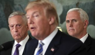 Defense Secretary Jim Mattis, left, and Vice President Mike Pence, right, listen to President Donald Trump, center, speaks in the Diplomatic Room of the White House in Washington, Friday, March 23, 2018, about the $1.3 trillion spending bill. (AP Photo/Pablo Martinez Monsivais) **FILE**