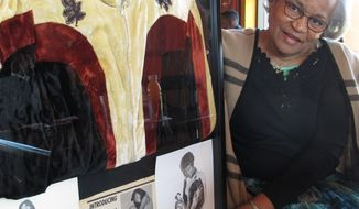 Ramona Isbell talks about her days as a professional wrestler in the 1960s and 1970s beside a framed collage of mementos including publicity photos and a jacket, on Monday, March 19, 2018, in Columbus, Ohio. A new documentary tells the story of black women professional wrestlers in the 1950s and 1960s, many of them from Columbus.  (AP Photo/Andrew Welsh-Huggins)