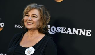 "Roseanne Barr arrives at the Los Angeles premiere of ""Roseanne"" on Friday, March 23, 2018, in Burbank, Calif. (Photo by Jordan Strauss/Invision/AP)"