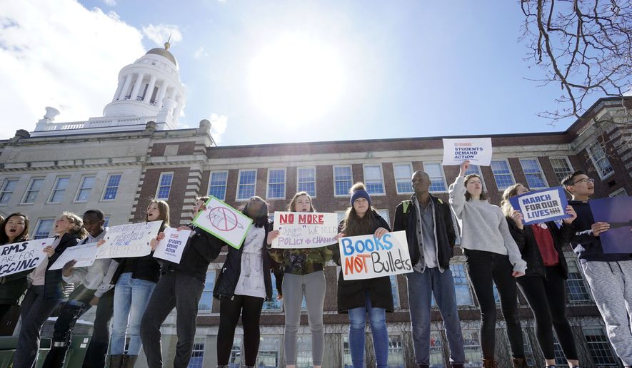 "Students chant with signs in Pittsfield, Mass., during a ""March For Our Lives""  on Saturday, March 24, 2018.  Summoned to action by student survivors from Marjory Stoneman Douglas High School in Parkland, Fla., hundreds of thousands of teenagers and their supporters rallied in the nation's capital and cities across the U.S. on Saturday to press for gun control. (Ben Garver /The Berkshire Eagle via AP)"