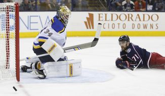 St. Louis Blues' Jake Allen, left, makes a save against Columbus Blue Jackets' Nick Foligno during the second period of an NHL hockey game Saturday, March 24, 2018, in Columbus, Ohio. (AP Photo/Jay LaPrete)