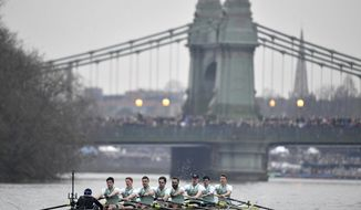 The Cambridge boat approaches Hammersmith Bridge during the Men's Boat Race on the River Thames, London, Saturday March 24, 2018. (Dominic Lipinski/PA via AP)
