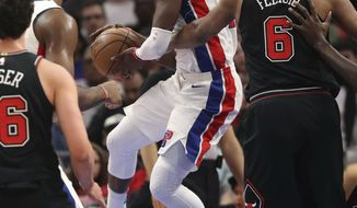 Detroit Pistons guard Reggie Jackson looks to pass during the first half of an NBA basketball game against the Chicago Bulls, Saturday, March 24, 2018, in Detroit. (AP Photo/Carlos Osorio)