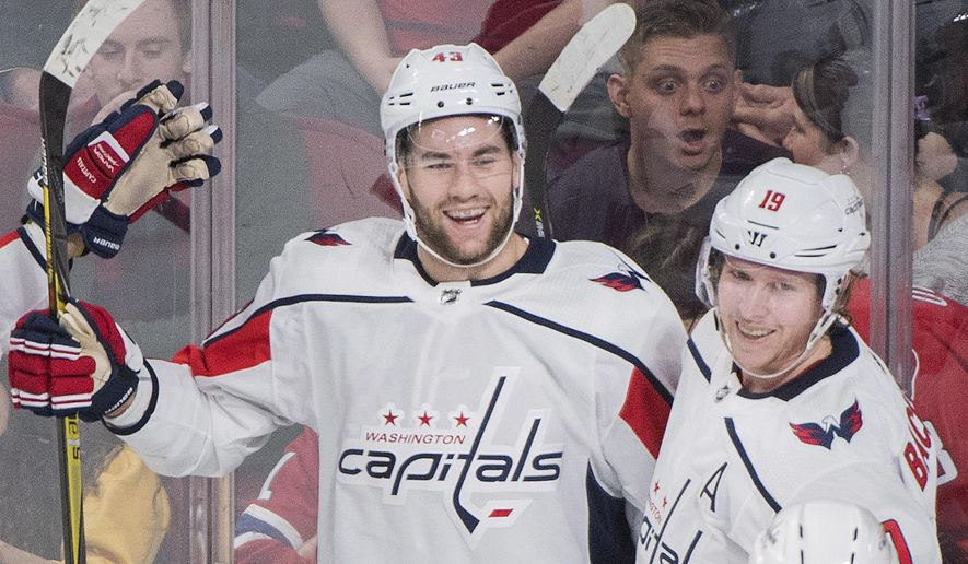 Washington Capitals' Tom Wilson (43), celebrates with teammate Nicklas Backstrom (19) after scoring against the Montreal Canadiens during first period NHL hockey action in Montreal, Saturday, March 24, 2018. (Graham Hughes/The Canadian Press via AP) ** FILE **