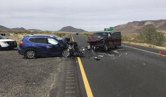 In this photo provided by the Arizona Department of Public Safety, two cars involved in a wrong-way crash that killed three people sit on Interstate 10 near Quartzsite, Ariz., on Saturday, March 24, 2018. The Arizona Department of Public Safety says the wreck occurred when a vehicle used an exit ramp to enter the freeway and then collided with another vehicle about 500 feet (152 meters) from the exit ramp. (Arizona Department of Public Safety via The AP)