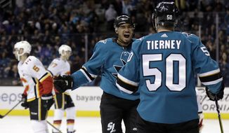 San Jose Sharks' Evander Kane, center, celebrates his goal with teammate Chris Tierney (50) during the second period of an NHL hockey game against the Calgary Flames Saturday, March 24, 2018, in San Jose, Calif. (AP Photo/Marcio Jose Sanchez)