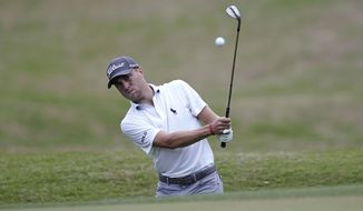 Justin Thomas chips to the seventh green during round four at the Dell Technologies Match Play golf tournament, Saturday, March 24, 2018, in Austin, Texas. (AP Photo/Eric Gay)