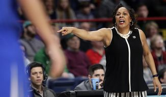 Buffalo head coach Felisha Legette-Jack calls out to her team during the first half of a regional semifinal against South Carolina at the NCAA women's college basketball tournament Saturday, March 24, 2018, in Albany, N.Y. (AP Photo/Frank Franklin II)