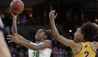 Oregon forward Ruthy Hebard (24) shoots in front of Central Michigan forward Tinara Moore (2) during the first half in a regional semifinal at the NCAA women's college basketball tournament, Saturday, March 24, 2018, Spokane, Wash. (AP Photo/Young Kwak)