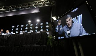Villanova coach Jay Wright is seen on a monitor as he speaks during a news conference at the NCAA men's college basketball tournament, Saturday, March 24, 2018, in Boston. Villanova faces Texas Tech in a regional final on Sunday. (AP Photo/Elise Amendola)