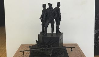 """A model of the """"Project Zebra"""" memorial stands in the Arts of the Albemarle building in Elizabeth City, N.C., on Monday, March 12, 2018. The city council initially OK'd the Russian-financed monument commemorating the World War II operation, but a new council has declined to sign a memorandum of understanding that would allow the plan to proceed. (AP Photo/Martha Waggoner)"""