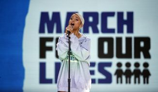 "Ariana Grande performs ""Be Alright"" during the ""March for Our Lives"" rally in support of gun control, Saturday, March 24, 2018, in Washington. (AP Photo/Alex Brandon)"