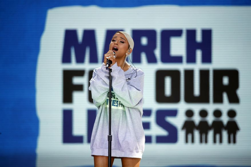 """Ariana Grande performs """"Be Alright"""" during the """"March for Our Lives"""" rally in support of gun control, Saturday, March 24, 2018, in Washington. (AP Photo/Alex Brandon)"""