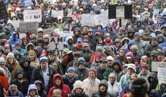 Demonstrators gather outside city hall during the March for Our Lives protest for gun legislation and school safety, Saturday, March 24, 2018, in Cincinnati. Students and activists across the country planned events Saturday in conjunction with a Washington march spearheaded by teens from Marjory Stoneman Douglas High School in Parkland, Fla., where over a dozen people were killed in February. (AP Photo/John Minchillo)