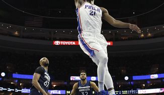 Philadelphia 76ers' Joel Embiid, of Cameroon, goes up for the dunk during the first half of an NBA basketball game against the Minnesota Timberwolves, Saturday, March 24, 2018, in Philadelphia. (AP Photo/Chris Szagola)