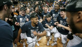 Phil Booth, center, leads Villanova players celebrating their win over Texas Tech in an NCAA men's college basketball tournament regional final, Sunday, March 25, 2018, in Boston. Villanova won 71-59 to advance to the Final Four. (AP Photo/Elise Amendola)