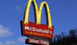 This Friday, March 17, 2017, photo shows the McDonald's sign outside a restaurant in downtown Pittsburgh. McDonald's Corp. reports earnings, Tuesday, July 25, 2017. (AP Photo/Gene J. Puskar)