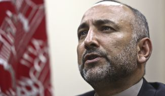 """We should negotiate with anyone who is reconcilable,"" including elements of the Haqqani Network, Afghan National Security Adviser Mohammad Hanif Atmar, told the Times shortly after a breakfast round table with reporters at the Afghan embassy in Washington on Thursday. (Associated Press)"
