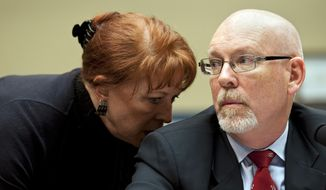 Gregory Hicks, former Deputy Chief of Mission in Libya, right, confers with his attorney Victoria Toensing as he testifies before the House Oversight and Government Reform Committee's hearing on Benghazi: Exposing Failure and Recognizing Courage on Capitol Hill in Washington, Wednesday, May 8, 2013. (AP Photo/Cliff Owen)