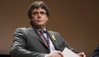 "In this March 18, 2018, file photo Catalan's fugitive ex-president Carles Puigdemont, takes part in a panel titled ""Self-Determination,"" at the International Film Festival and Forum on Human Rights, in Geneva, Switzerland.(Salvatore Di Nolfi/Keystone via AP, file)"
