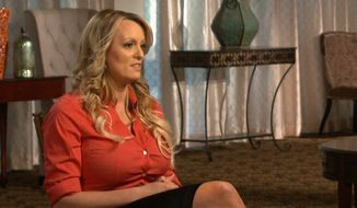 "This image released by CBS News shows Stormy Daniels, left, during an interview with Anderson Cooper that aired on Sunday, March 25, 2018, on ""60 Minutes."" (CBS News/60 Minutes via AP)"